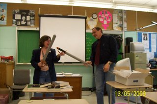 Lynda Williams staging mock challenge under sword law with Terrace B.C. teacher Al Lehmann